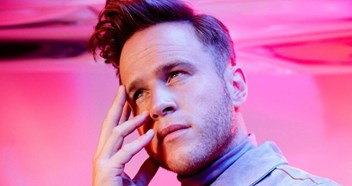 """Bring it on!"" Olly Murs talks chart battle with Muse and celebrating a decade in music"