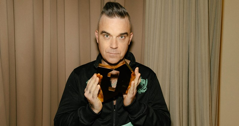 Robbie Williams's Christmas album hits Number 1, matches Elvis chart record